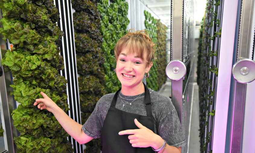 Freight Farm coordinator Elsa Bohl talks about the current eight-week old lettuce crop Monday