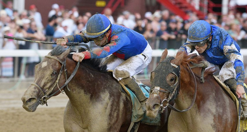 Bell's the One, left, ridden by Corey Lanerie and trained by Neil Pessin, wins the Grade II Honorable Miss Stakes at Saratoga Race Course in Saratoga Springs on Wednesday.