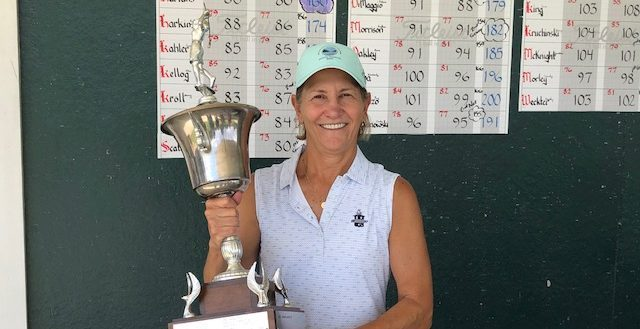 Heidi Harkins of Ballston Spa Country Club hoists the trophy after winning her first NEWGA Championship Wednesday at Colonie Golf & Country Club.