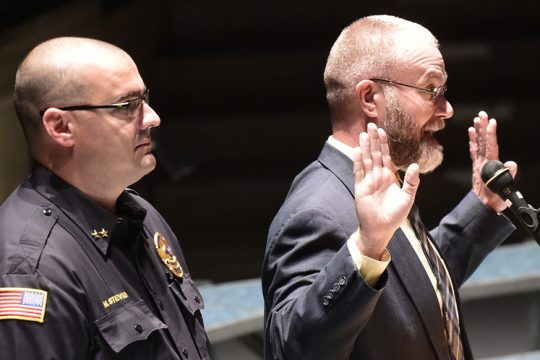 This November 2018 photo shows Niskayuna Police Deputy Chief Michael Stevens, one of three candidates to be interviewed for Chief,with former NiskayunaSuperintendent Cosimo Tangorra, Jr. addressing a high school auditorium crowd at a forum regarding bomb threats.