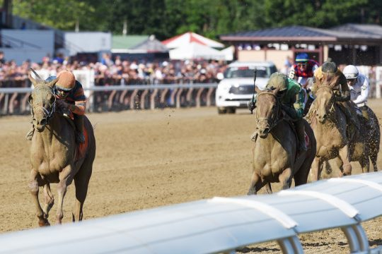 Dynamic One, left, ridden by Irad Ortiz, Jr., runs away from Miles D, center, and First Captain to win the Curlin at Saratoga on Friday.