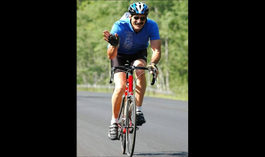 Art Clayman, president of Cycle Schenectady, and vice president of the Electric City Bike Rescue, is seen riding in 2012.