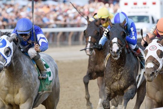 Essential Quality and jockey Luis Saez, left, hold off Keepmeinmind, right, to win the Jim Dandy at Saratoga on Saturday.