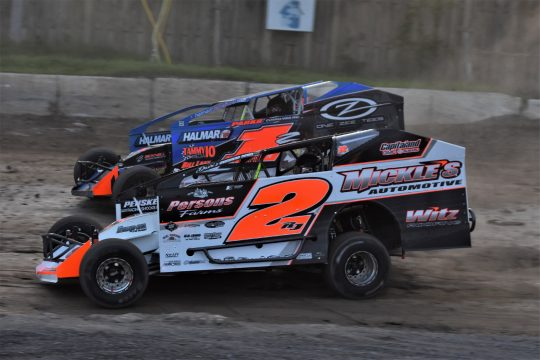 Ronnie Johnson (2RJ) and JessicaFriesen (1Z) battle for position during modified heat race action Saturday night at Fonda Speedway. (James A. Ellis)