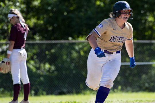 Amsterdam catcher Shelby LaMont roundssecond base after hitting a three-run home run in a Section II Class A semifinal softball game against Burnt Hills-Ballston Lake on June 10 at Shuttleworth Park in Amsterdam.