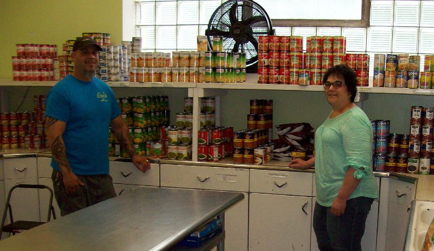 The Catholic CharitiesFood Pantry in Amsterdamis pcitured with Alice Burgado, food pantry coordinator and David Lopez,pantry Assistant.