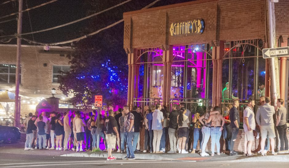 A line forms outside Gaffney's in downtown Saratoga Springs as crowds fill the bars on Caroline Street on Friday.