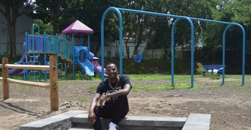 Tyrell Outlaw, otherwise known as Rell Dolo, sits on the recently completed steps at Landon Terrace Park.