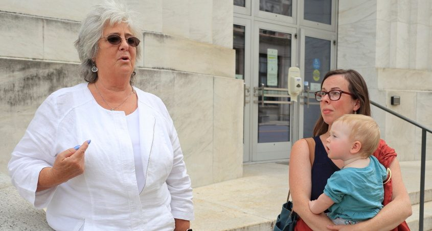 Bonnie Rosengrant and Melanie O'Malley (with daughter Hazel) speak to reporters outside the federal courthouse in Albany on Wednesday