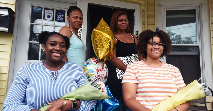 Keziah Breedlove, left, and Sabina Monroe, right are the latest recipients of The Naylon Carrington Project Foundation Scholarship Award presented by Sondra Banks, second from left, and her daughter, Ceniya Fountain, third from left