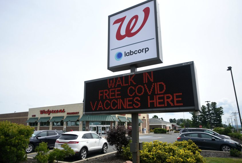 A sign at the Amsterdam Walgreens advertises free walk-in COVID vaccinations on Thursday.