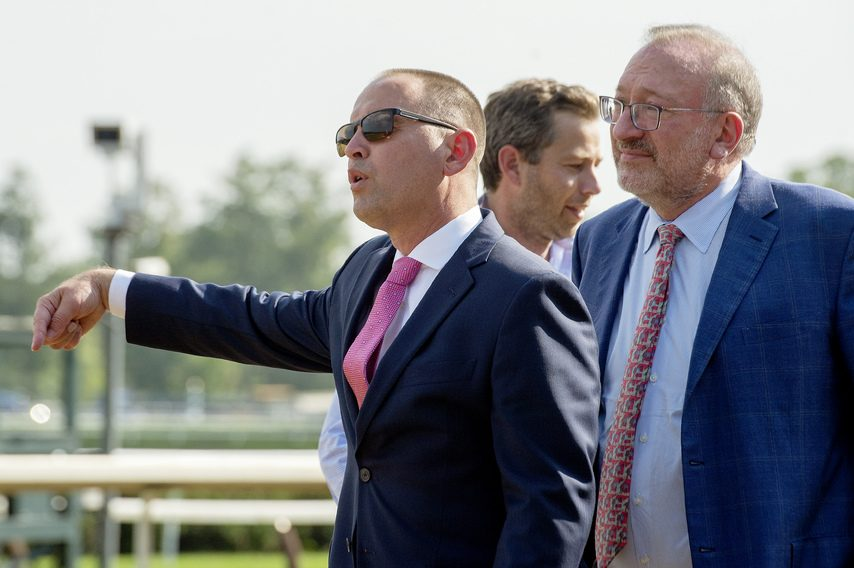 Trainer of Chad Brown, left, and owner Seth Klarman wait for Public Sector to cool off after Klarman's colt Public Sector won the Grade II NMRHOF stakes at Saratoga on Friday.