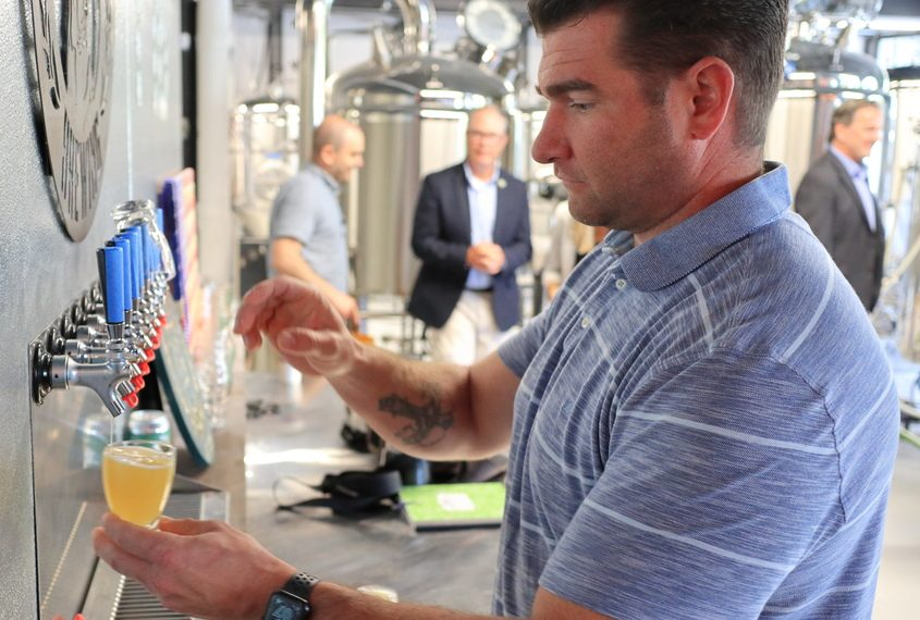 Guy Bucey, owner of Mixed Breed Brewing, draws a sample of one of the Guilderland craft brewery's beers Friday, Aug. 6, 2021.