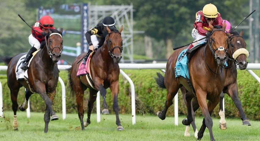 State of Rest and jockey John Velazquez (9) close strongly down the stretch to win the Saratoga Derby on Saturday.