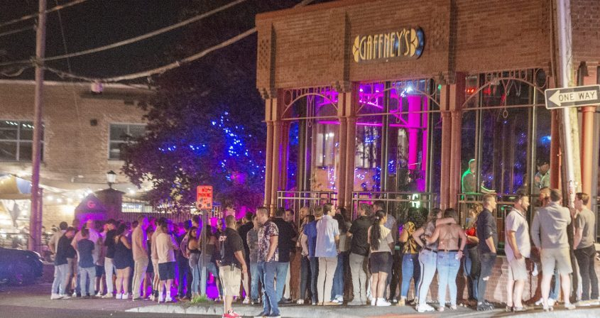 A long line of patrons waits to enter Gaffney's in downtown Saratoga Springs late at night on Friday, July 30, 2021.