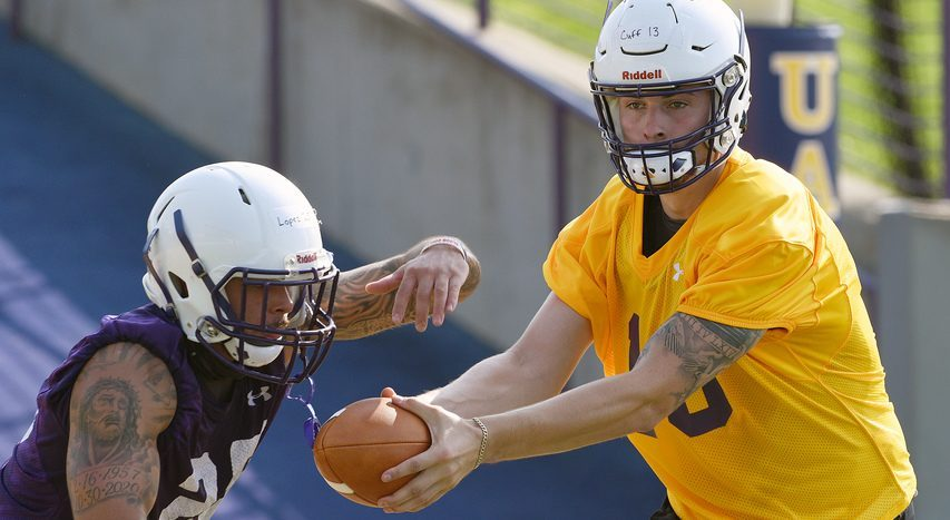 UAlbany quarterback Jeff Undercuffler, right, hands off to Jose Lopez-Quinones during practice at Tom & Mary Casey Stadium in Albany on Friday.