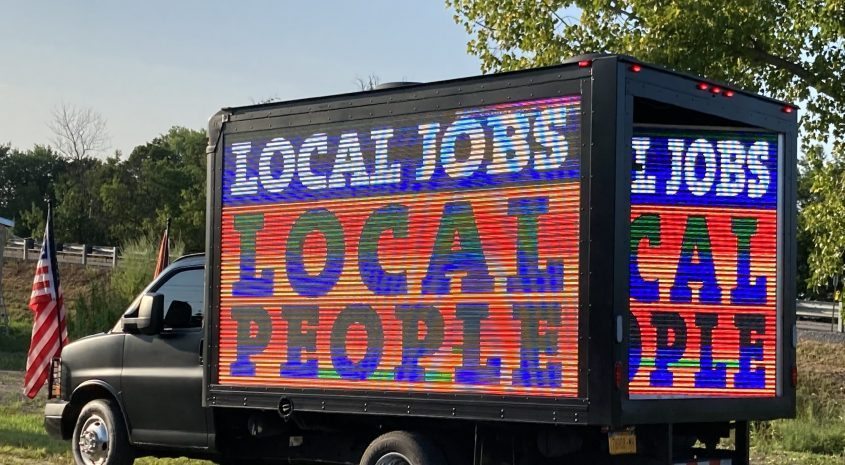 Union representatives parked a truck outside of Glen Town Hall Monday evening in support of the Mill Point Solar Project proposed by ConnectGen. New York State Laborers say the project would create 'good jobs' for construction workers, Aug. 10, 2021.