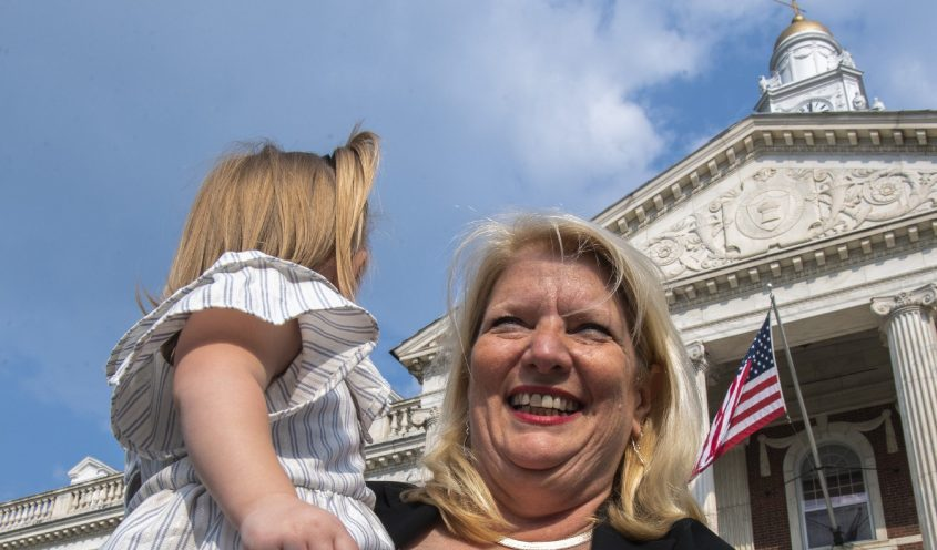 Karen Zalewski-Wildzunas announces her run for Schenectady City Council while holding her grandchild 2-year-old Charlotte Iwanowicz on the steps of City Hall on Tuesday