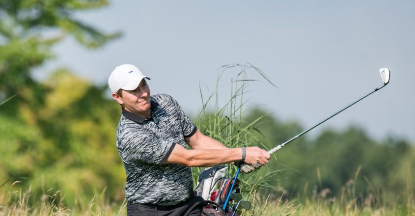 Siena College grad Kyle Downey of Locust Hill CC in Rochester follows through on a shot in the opening round of the 98th annual NYS Men's Amateur Golf Championship Tuesday at Schuyler Meadows Club. (NYSGA photo)