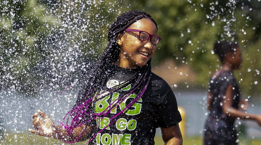 Niya McKeon, 11, of Pattersonville cools off on the splash pad in Scotia's Collins Park Tuesday