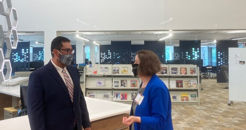 Jacquie Keleher, (right) director of library services, SUNY Schenectady Community College and Jeff Aranda, director of the Educational Opportunity Program, during the school's unveiling Tuesday