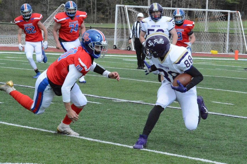 Johnstown's Brandon Frank (88) attempts to evade a tackle from Broadalbin-Perth's Jackson Sassanella during a football game onApril 17 at Patriot Field in Broadalbin.