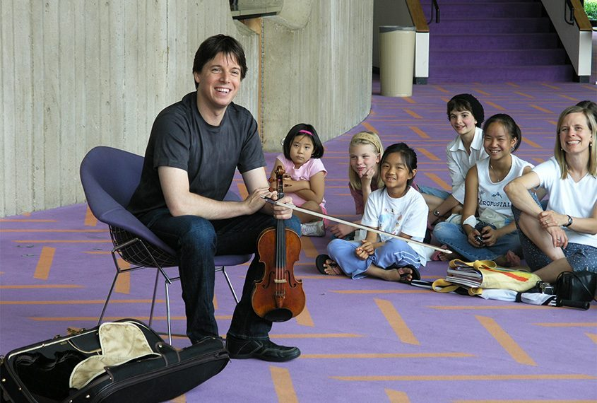 Joshua Bell shares a laugh with youngsters in this file photo.