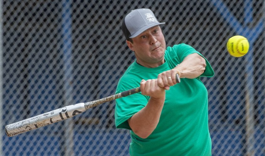 Team Rotterdam Town Board's Matt McDonald bats against the South Schenectady Fire Department team during the third annual Battle of the Badges Softball Tournament to benefit the Rotterdam Babe Ruth Youth Organization at Memorial Park in Rotterdam on Saturday afternoon.