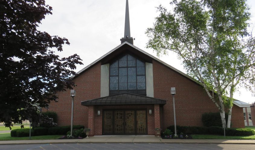 This photo shows the exterior of Our Lady Queen of Peace on Princetown Road in Rotterdam.