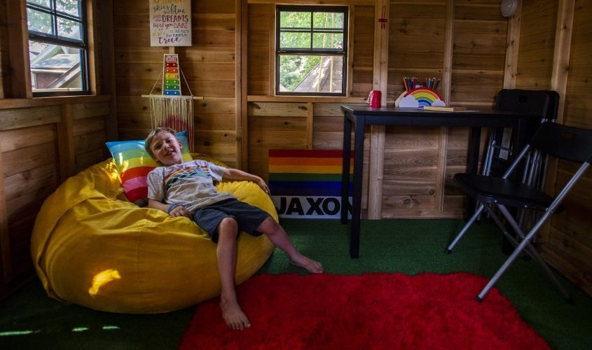 Jaxon Monlea, 8, relaxes in his tree house in his backyard on Thursday, August 12, 2021.