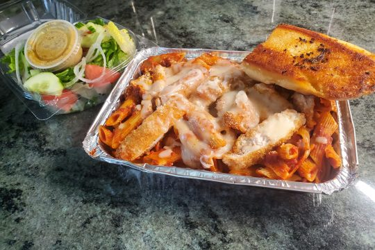 Chicken Parm dinner to-go with garden salad and garlic bread at DomAdi's Deli in Amsterdam.