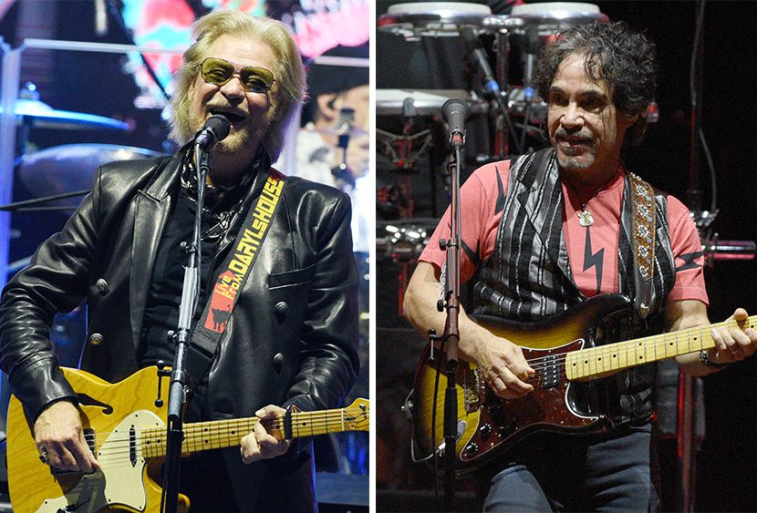 Daryl Hall, left, and John Oates perform on stage with their band Sunday night at Saratoga Performing Arts Center.