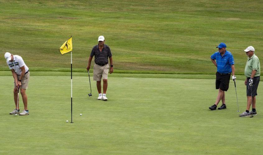 Shaun Scott, left, putts a birdie on the 18th green at Schenectady Municipal Golf Course with Tom Peplowski, Scott Oswald and Vern Estes on Tuesday.
