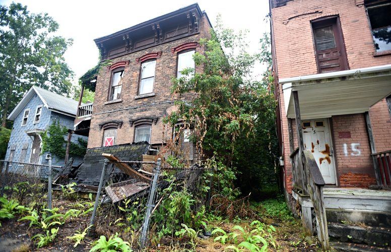 Three abandoned buildings — 11, 13 and 15 Voorhees St. —are among the buildings the city of Amsterdam hopes to demolish.