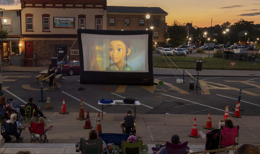 The Disney movie Raya and the Last Dragon plays on the big screen in front of Schenectady City Hall on Jay Street as part of the Downtown Schenectady Starlight Cinema on Aug. 4.
