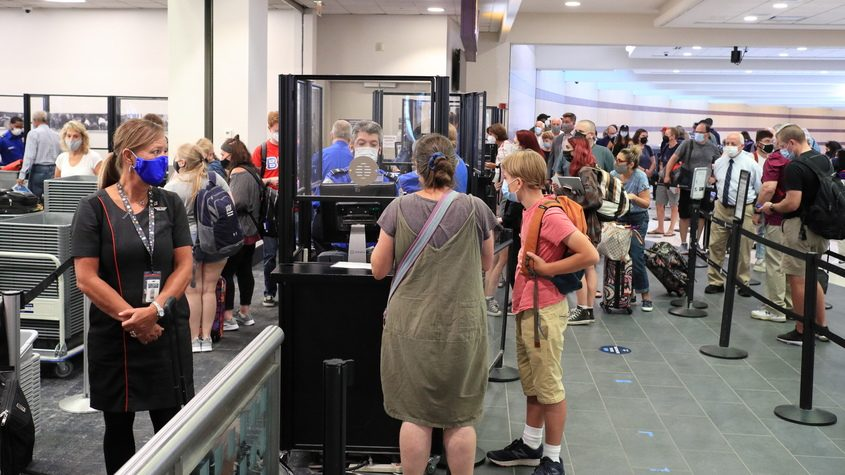 The Albany International Aiport security checkpoint is crowded around noon Wednesday, Aug. 18, 2021.