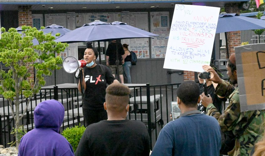 This June 2020 file photo shows BLM member and co-founder Khalifa Jackson speak at one of the nights' of BLM protests of the former Bumpy's Polar Freeze on State St. in Woodlawn.