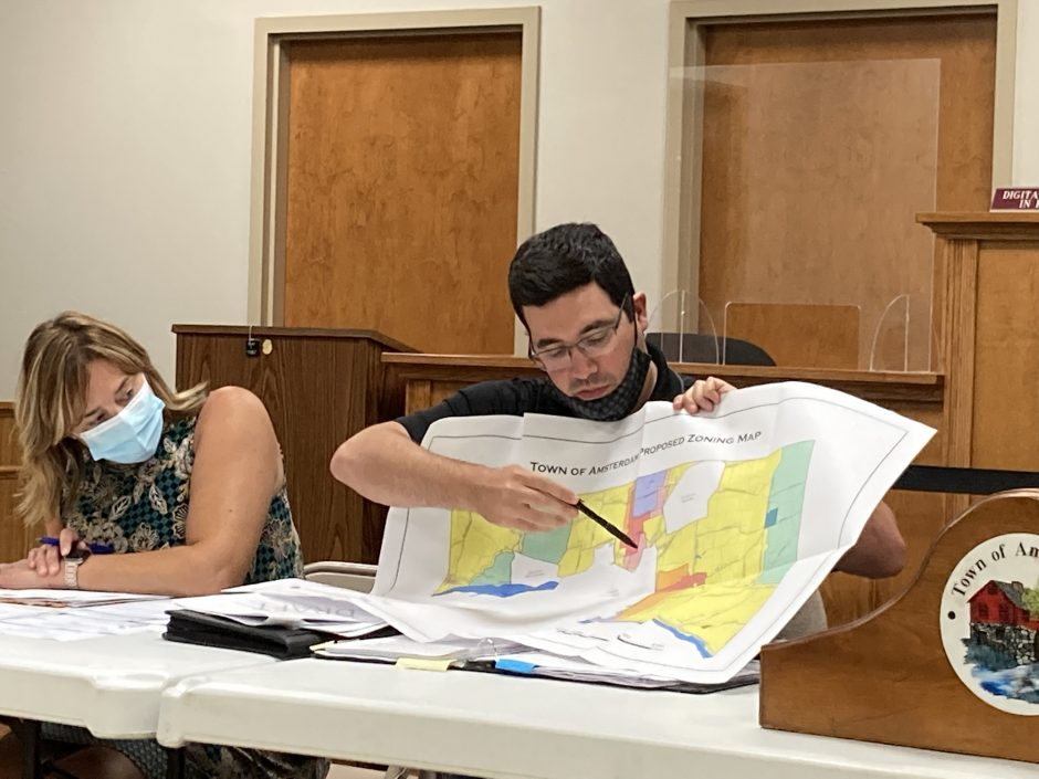 Town Engineer Kevin Schwenzfeier points to the commercial and industrial zoning districts in the town of Amsterdam where solar projects would continue to be allowed if a proposed local law is approved by the Town Board.