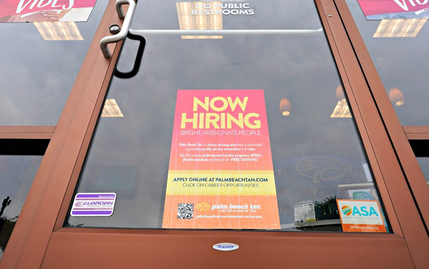 """A """"Now Hiring"""" sign at a business in Richmond, Va., Wednesday, June 2, 2021 is shown. U.S. employers posted a record 10.1 million job openings in June, another sign that the job market and economy are bouncing back briskly from last year's coronavirus shutdowns. The Labor Department reported Monday, Aug. 9, 2021 that job openings rose from 9.5 million in May. (Steve Helber/The Associated Press)"""