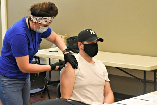Philip Alexander of Ballston Spa gets his Pfizer booster vaccine from RN Meghan Martterer of the Schenectady County Public Health Department on Thursday evening at the Alplaus Fire House.