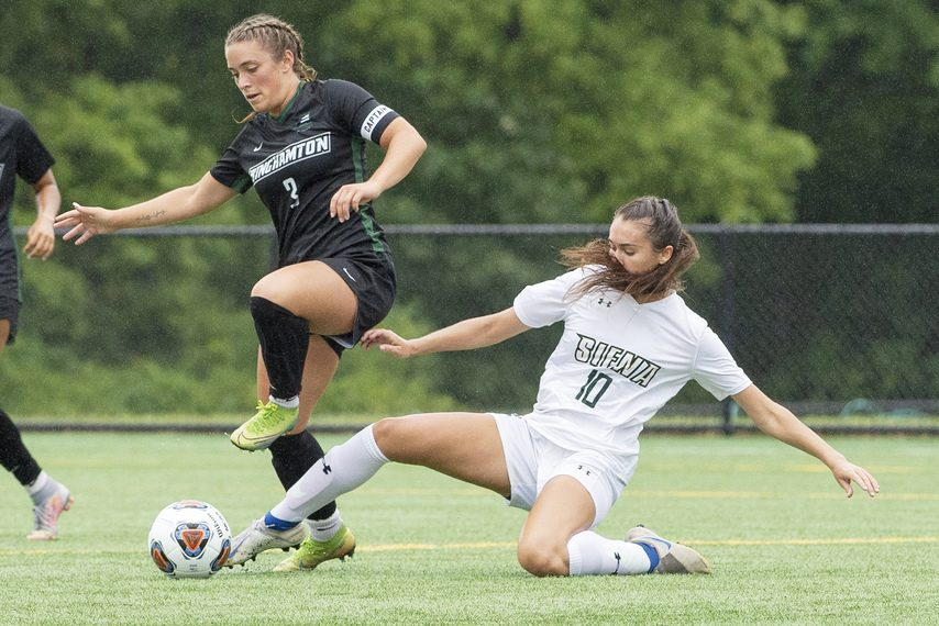 Siena's Katrina Kurtz slides to get the ball against Binghamton's Olivia McKnight during their soccer game at Siena College in Loudonville on Thursday, August 19, 2021.