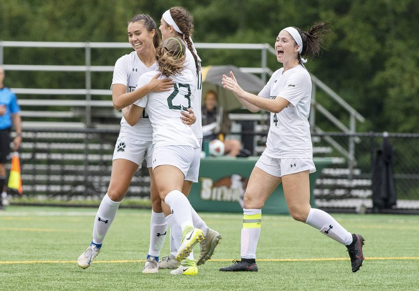 Siena teammates celebrate their first goal against Binghamton during their first soccer game of the season at Siena College in Loudonville on Thursday, August 19, 2021.