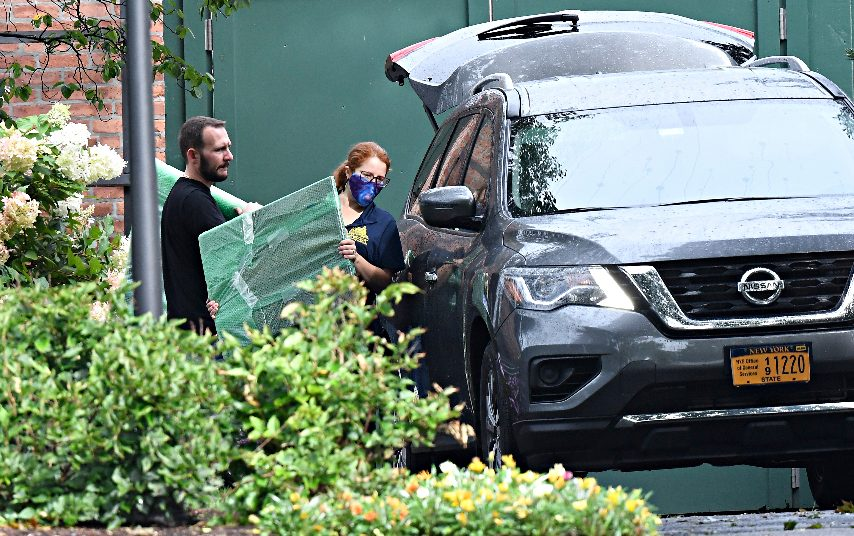 Crews from the Office of General Services load belongings of New York Gov. Andrew Cuomo into vehicles at the New York state Executive Mansion, Friday Aug. 20, 2021, in Albany, N.Y. Lt. Gov. Kathy Hochul will become the first woman to be New York's governor when Cuomo's resignation becomes official on Aug. 24. (Hans Pennink/The Associated Press)