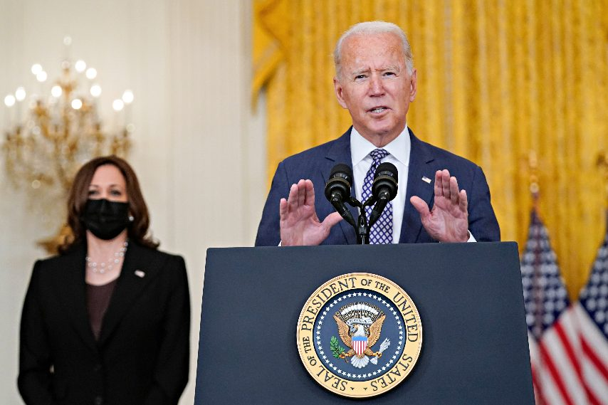 President Joe Biden speaks about the evacuation of American citizens, their families, SIV applicants and vulnerable Afghans in the East Room of the White House, Friday, Aug. 20, 2021, in Washington. Vice President Kamala Harris listens at left. (Manuel Balce Ceneta/The Associated Press)