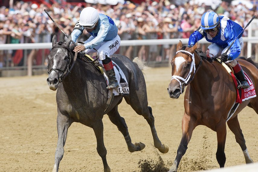 Maracuja, left, gets past Malathaat to win the Coaching Club American Oaks at Saratoga on July 24.