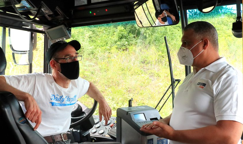 Daily Gazette Business Editor John Cropley talks with CDTA Safety and Training Supervisor Juan Ovalle after test driving a CDTA bus Friday. (Photo by Jaime Kazlo/CDTA)