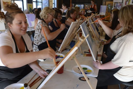 A paint and sip in full swing atSaratoga Paint & Sip on Henry Street in Saratoga Springs.
