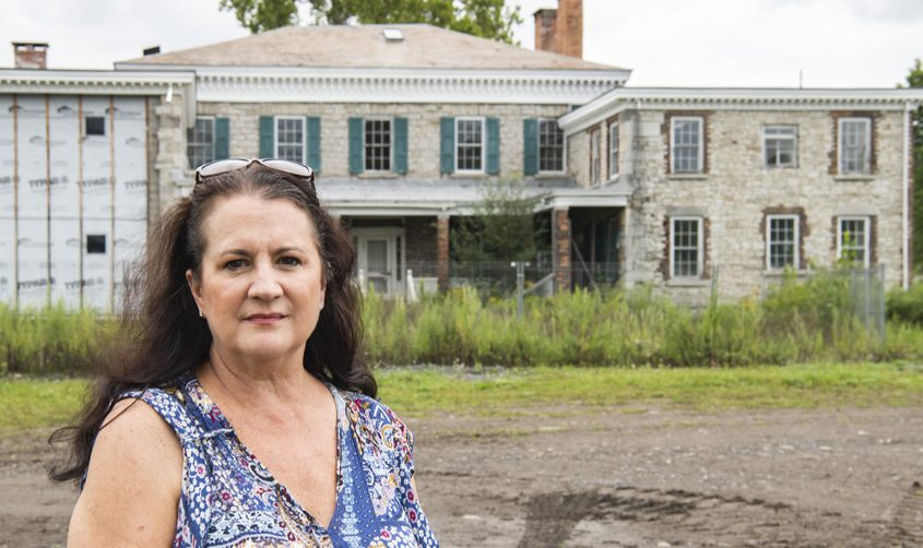 Ann Peconie stands in front of former site of the Elwood Museum at Lock 11 in Amsterdam