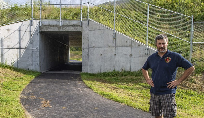Rotterdam Junction fire chief Shawn Taylor stands Aug. 13 near the bike path tunnel under the CSX railway tracks that also serves as a drainage tunnel in case of a flood