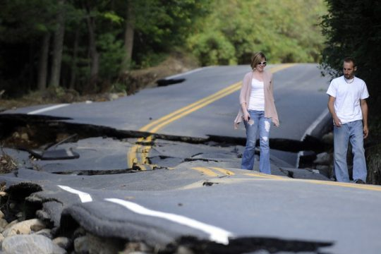 Jarrid Gonyea and his wife Michelle Gonyea of Wilmington , N.Y., check out storm damage on Hurricane Rd. caused by Tropical Storm Irene in the Town of Keene , N.Y., Monday, Aug. 29, 2011. (AP Photo/Hans Pennink)
